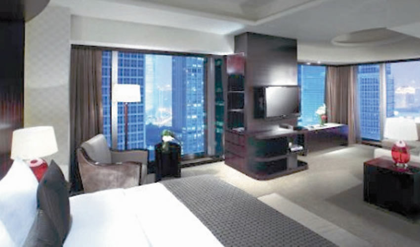 Shanga, China.- Esta es una de las lujosas y confortables habitaciones del Grand Hotel Kempinski, de 5 estrellas: su costo, desde los 3 mil pesos por noche en adelante, por persona. (Foto: Cortesía)